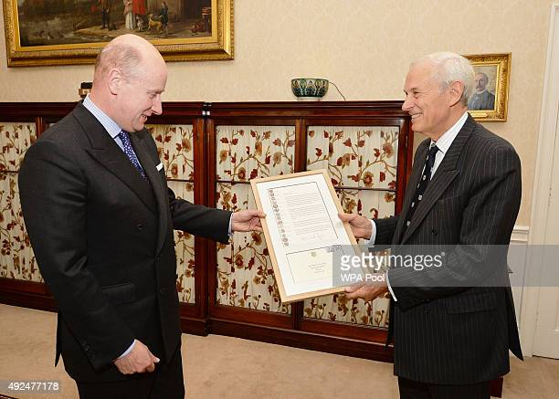 The Queen's private secretary Sir Christopher Geidt is presented by Confederation of Cinque Ports representative Lord Boyce with a letter...