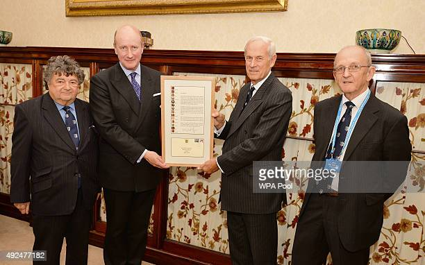 The Queen's private secretary Sir Christopher Geidt is presented with a letter congratulating Queen Elizabeth II on becoming Britain's longest...