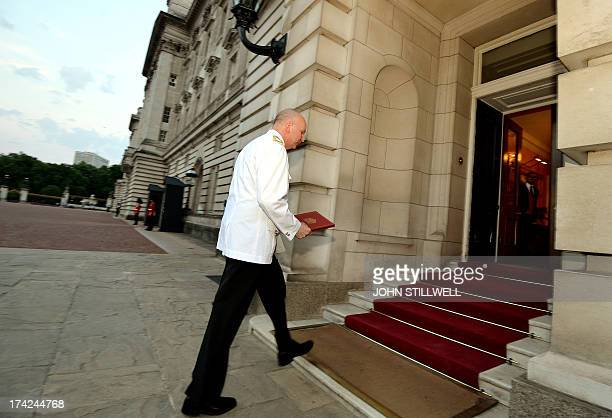 The Queen's senior Page Philip Rhodes carries the official notification into Buckingham Palace, that announces the birth of a baby boy at 4.24pm to...