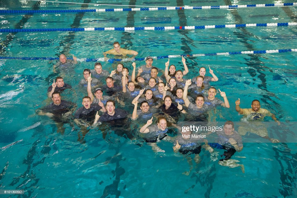 The Queens University team celebrates their first place finish during the Division II Men's and Women's Swimming & Diving Championship held at the Birmingham CrossPlex on March 11, 2017 in Birmingham, Alabama.