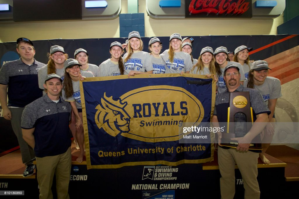 The Queens University team receives their first place trophy during the Division II Men's and Women's Swimming & Diving Championship held at the Birmingham CrossPlex on March 11, 2017 in Birmingham, Alabama.