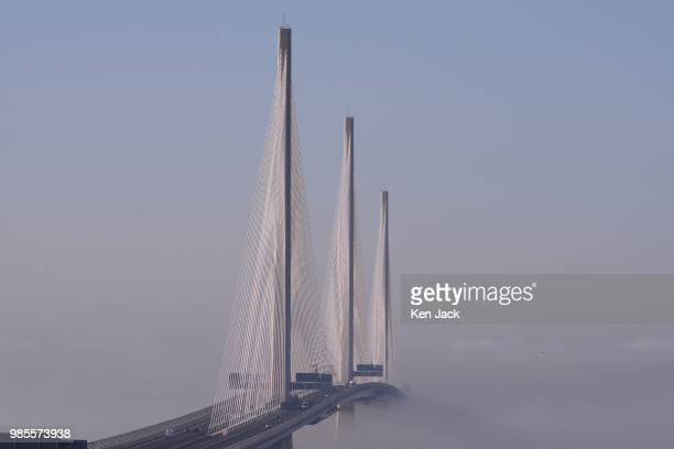 The Queensferry Crossing road bridge over the Forth Estuary appears to float as mist envelopes the support pillars on June 27 2018 in South...