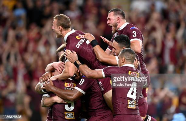The Queensland players celebrate victory during game three of the State of Origin series between the Queensland Maroons and the New South Wales Blues...