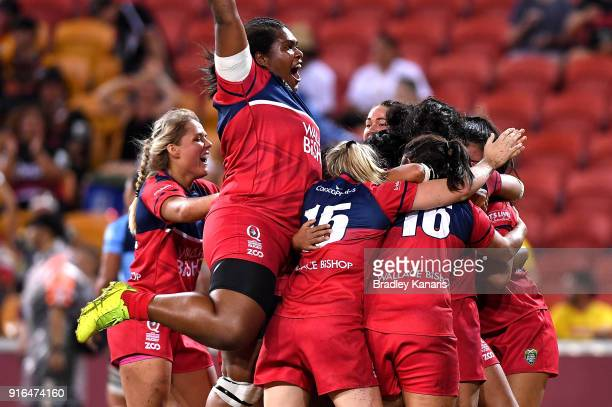 The Queensland Reds celebrate victory after defeating the New South Wales Blues in the Women's Grand Final match during the 2018 Global Tens at...