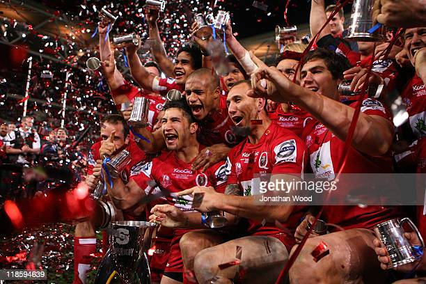 The Queensland Reds celebrate victory in the 2011 Super Rugby Grand Final match between the Reds and the Crusaders at Suncorp Stadium on July 9 2011...