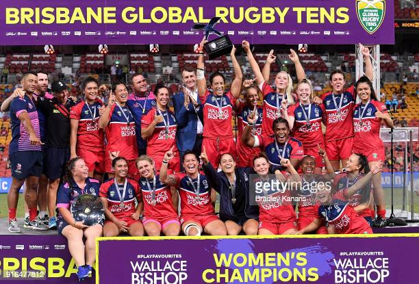 The Queensland Reds Women's team celebrate victory after defeating the New South Wales Blues in the grand final at Suncorp Stadium on February 10...
