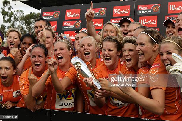 The Queensland Roar women celebrate after victory in the WLeague 2009 Grand Final match between the Queensland Roar and Canberra United at Ballymore...