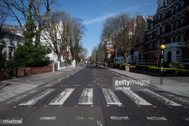 The quiet roads and pavements around the iconic Abbey Road pedestrian crossing are seen on March 24 2020 in London England British Prime Minister...