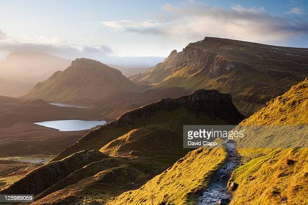 the quiraing: twenty four mile rock ledge in spectacular light on isle of skye, scotland, uk (22nd january 2010) - land geografisches gebiet stock-fotos und bilder