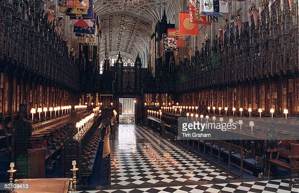 The Quire In Stgeorge's Chapel Above The Garter Stalls Hang The Banners Of The Knights Of The Garter Below Which Are Displayed Their Crests Helmets...