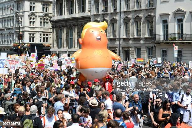 The quotTrump Babyquot balloon joins demonstrators as they march through Parliament Square in London as part of the protests against the visit of US...