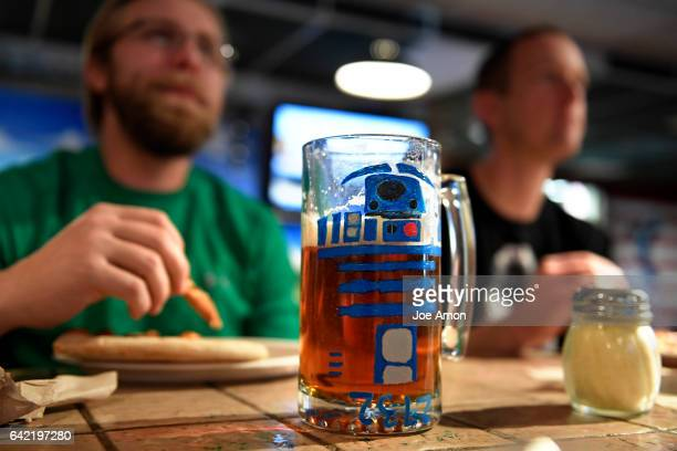 The R2D2 mug sits in front of Darren Standiford of Lakewood having pizza and beer with his friend Andy Mohrhaus of Aurora during a break from skiing...