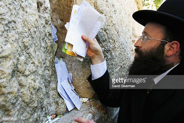 The Rabbi of the Western Wall Rabbi Shmuel Rabinovitch places letters to God between the ancient stones of Judaism's holiest site June 15 2005 in...