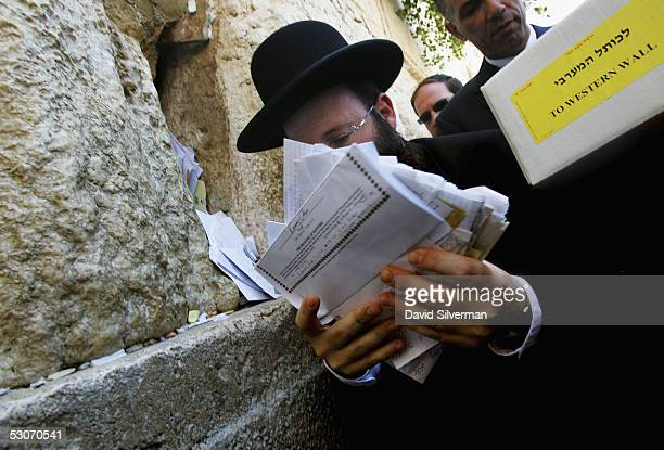 The Rabbi of the Western Wall Rabbi Shmuel Rabinovitch receives letters to God from an Israeli postal worker to place between the ancient stones of...