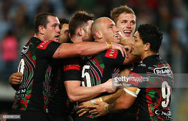 The Rabbitohs celebrate a try by Greg Inglis during the round 23 NRL match between the South Sydney Rabbitohs and the Brisbane Broncos at ANZ Stadium...