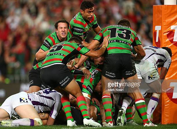 The Rabbitohs celebrate a try by Issac Luke during the NRL Qualifying match between the South Sydney Rabbitohs and the Melbourne Storm at ANZ Stadium...