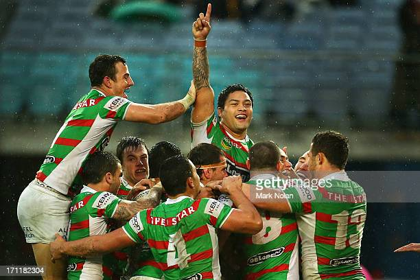 The Rabbitohs celebrate a try by John Sutton during the round 15 NRL match between the Parramatta Eels and the South Sydney Rabbitohs at ANZ Stadium...