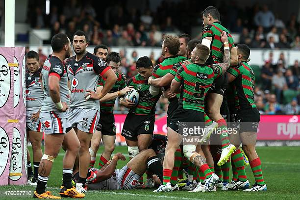 The Rabbitohs celebrate a try by Tim Grant during the round 13 NRL match between the South Sydney Rabbitohs and the New Zealand Warriors at nib...