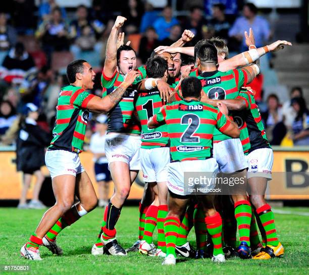 The Rabbitohs celebrate after winning the round 16 NRL match between the North Queensland Cowboys and the South Sydney Rabbitohs at Dairy Farmers...