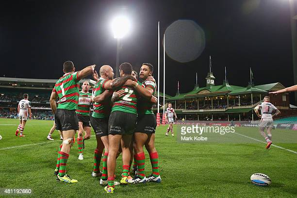 The Rabbitohs celebrate with Alex Johnston of the Rabbitohs after he scored a try during the round 19 NRL match between the St George Illawarra...