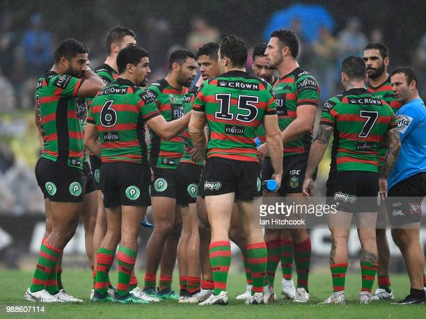 The Rabbitohs stand together in a huddle during the round 16 NRL match between the South Sydney Rabbitohs and the North Queensland Cowboys at Barlow...
