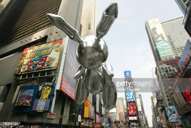 The Rabit balloon by artist Jeff Koons floats in Times Square during the 81st annual Macy's Thanksgiving Day Parade on November 22 2007 in New York...