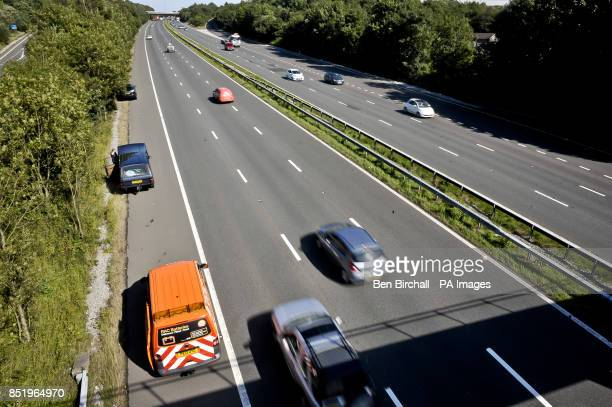 The RAC rescue service attend a broken down vehicle on the M5 Motorway near Bridgend Wales
