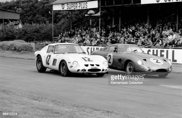 The RAC Tourist Trophy Goodwood August 24 1963 Mike Parkes in the Ferrari 250GTO braking against Innes Ireland in the Aston Martin DP214 for Madgwick...