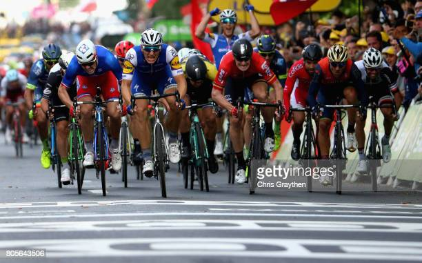 The race for the line between Marcel Kittel of Germany and QuickStep Floors Arnaud Demare of France and FDJ Andre Greipel of Germany and Lotto Soudal...