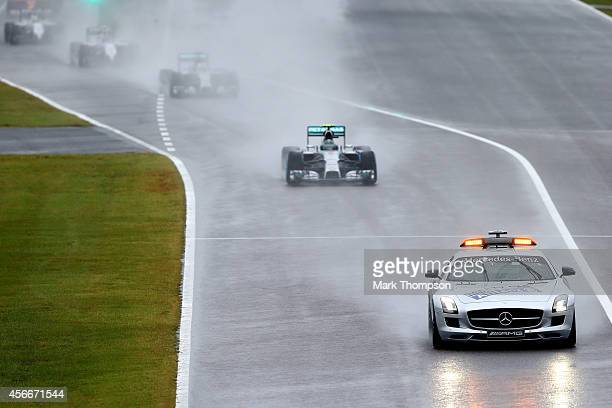 The race restarts from the pit lane under the safety car during the Japanese Formula One Grand Prix at Suzuka Circuit on October 5 2014 in Suzuka...
