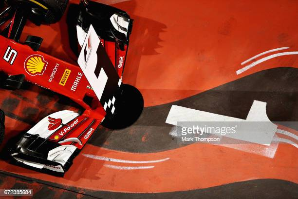 The race winning car of Sebastian Vettel of Germany and Ferrari in parc ferme during the Bahrain Formula One Grand Prix at Bahrain International...