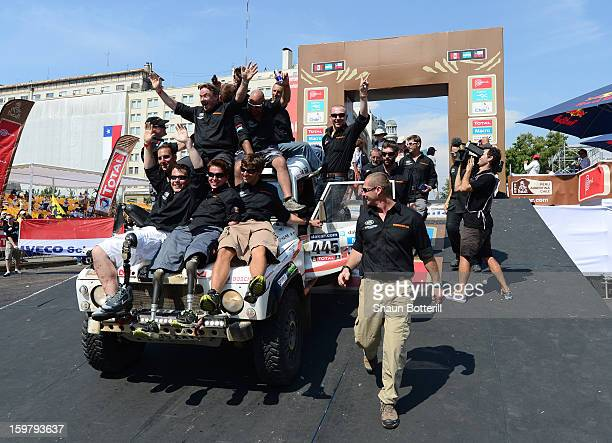 The Race2Recovery team celebrate during the podium presentations at the end of the 2013 Dakar Rally on January 20 2013 in Santiago Chile