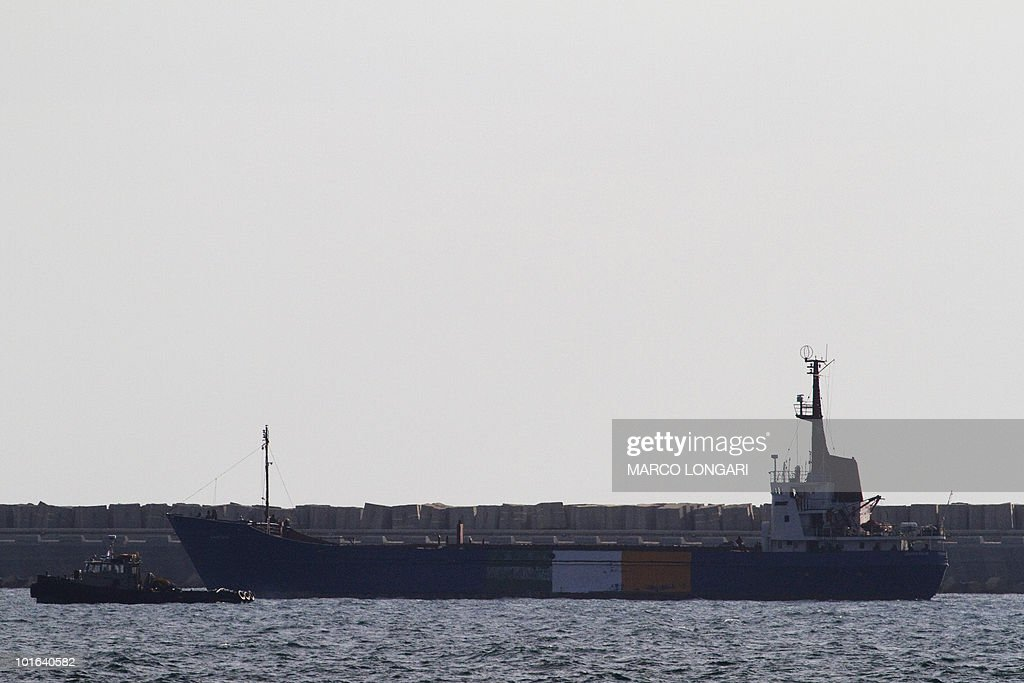 The Rachel Corrie aid ship, marked with the orange, white and green of the Irish flag, enters the military port of Ashdod in southern Israel on June 5, 2010, after the 1,200-tonne vessel was prevented by Israeli naval forces from reaching the Gaza Strip to deliver around 1,000 tonnes of aid and supplies, half of which was reportedly cement -- a substance which Israel does not allow into the Hamas-run impoverished territory.