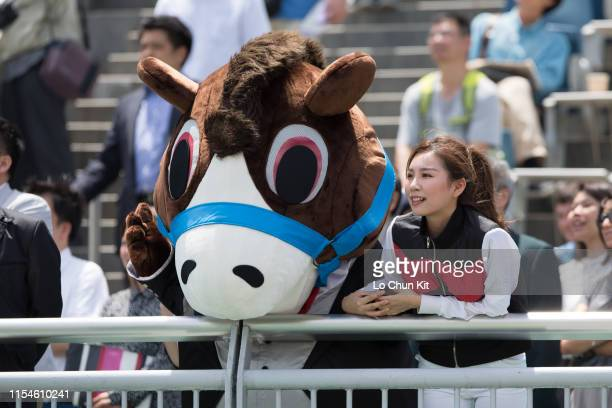 The Racing Club cheering team supporting their horse YOUNG EMPIRE during the Race 2 Lei Yue Mun Park Handicap at Sha Tin Racecourse on June 8 2019 in...