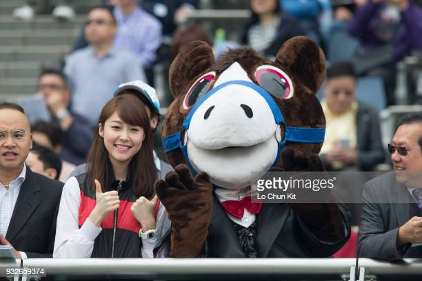 KONG – MARCH The Racing Club cheering team supporting their horse Young Ranger during the Race 3 Helene Mascot Handicap at Sha Tin racecourse on...