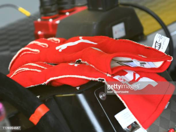 The racing gloves of Joey Logano Team Penske Ford Mustang Shell Pennzoil sit on the dashboard of the car during practice for the Monster Energy Cup...