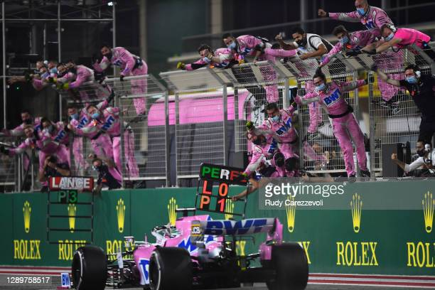 The Racing Point team celebrate on the pitwall as Sergio Perez of Mexico driving the Racing Point RP20 Mercedes crosses the finish line to win during...