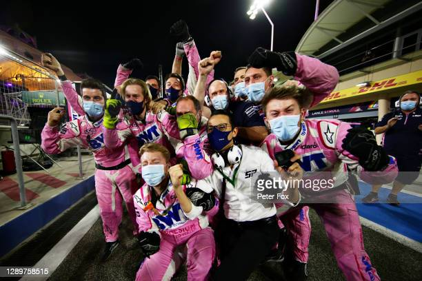 The Racing Point team celebrate the race win of Sergio Perez of Mexico and Racing Point during the F1 Grand Prix of Sakhir at Bahrain International...