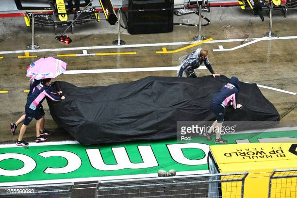 The Racing Point team work in the Pitlane during final practice for the Formula One Grand Prix of Styria at Red Bull Ring on July 11 2020 in...