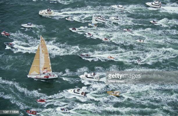 The racing yacht Tokio leads a flotilla of small boats out of harbour during the Whitbread round the World yacht race on 1st February 1994 in...