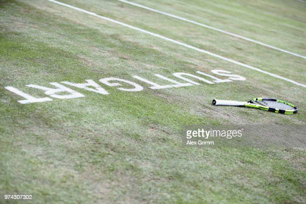 The racket of Benoit Paire of France is lying on the grass during his match against Tomas Berdych of Czech Republic during day 4 of the Mercedes Cup...