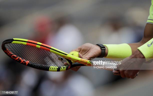 The racket of Spain's Rafael Nadal is pictured as he prepares to serve a ball to Germany's Yannick Hanfmann during their men's singles first round...
