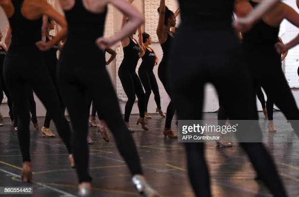 The Radio City Rockettes dance during rehearsals in New York October 12 2017 for the 2017 Christmas Spectacular Starring the Radio City Rockettes as...