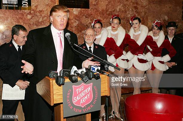 The Radio City Rockettes listen as Donald Trump speaks during a ceremony to help The Salvation Army kick off its annual Christmas kettle effort at...