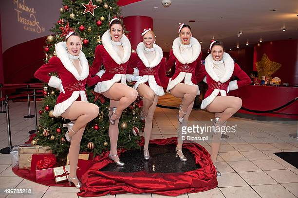 The Radio City Rockettes pose with a Radio City Rockette wax figure at Madame Tussauds on December 3 2015 in New York City
