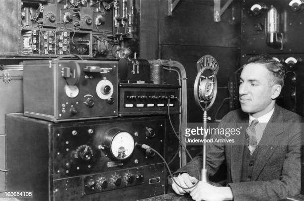 The radio operator at Station WYNC with the equipment that is to be used to send alarms to cruising police cars and stations New York New York circa...