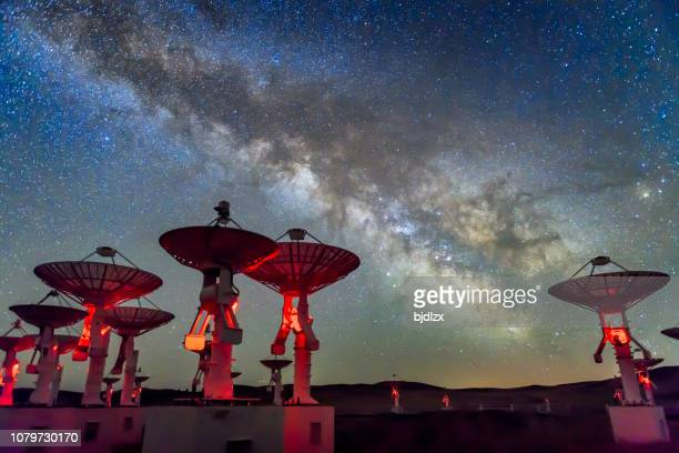 the radio spectrum imager array under the milky way galaxy - astrophysics stock pictures, royalty-free photos & images