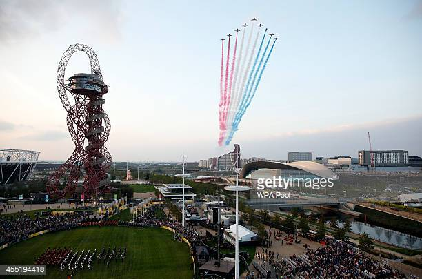 The RAF Aerobatic Team The Red Arrows perform during the opening ceremony of the Invictus Games at Queen Elizabeth II Park on September 10 2014 in...
