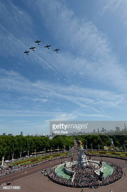 The RAF flypast containing three Spitfires and two Hurricaines passes over Buckingham Palace to commemorate the 75th Anniversary Of The Battle Of...