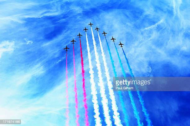 The RAF Red Arrows display team perform before the British Formula One Grand Prix at Silverstone Circuit on June 30 2013 in Northampton England